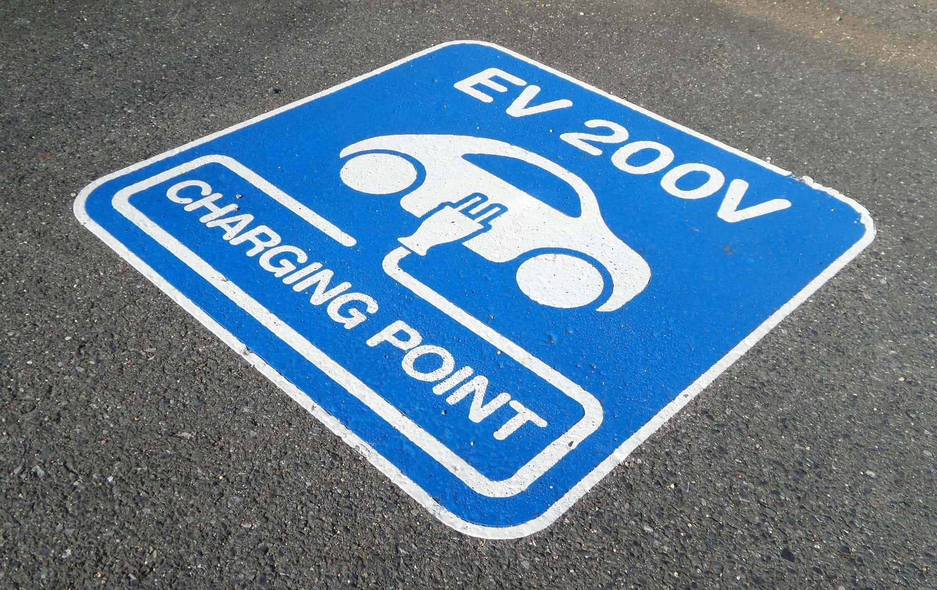Electric vehicle charging sign painted on the road